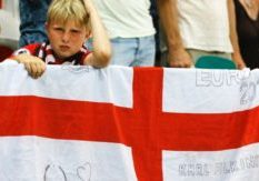 A young England supporter reacts at the end of the the Euro 2016 round of 16 soccer match between England and Iceland, at the Allianz Riviera stadium in Nice, France, Monday, June 27, 2016. (AP Photo/Kirsty Wigglesworth)